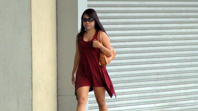 Chubby FIlipina in dress walking down the road