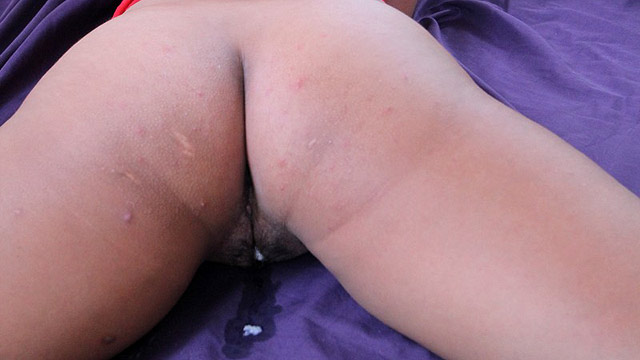 Cum drips from Filipina pussy whole laying on bed with legs shaking
