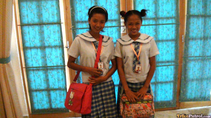 Filipina schoolgirls in uniform pose