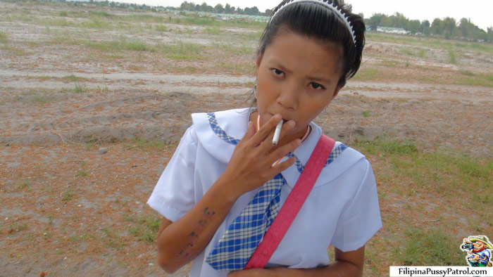 Smoking Filipina Schoolgirl In a Field