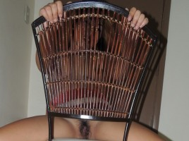 Hairy Filipina Pussy Mistress for Christmas exposed through wooden chair