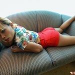 Sexy Pinay stretches out on the couch wearing shorts and top