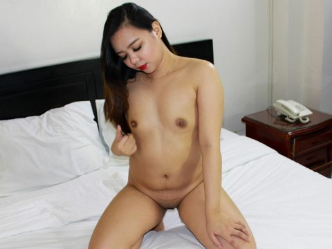 Asian pornstar models seductively in bed showing her small beautiful tits